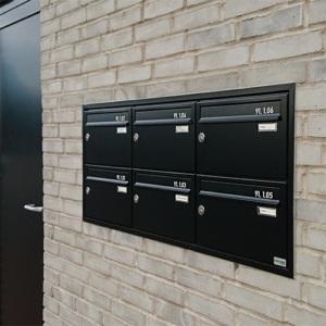 indmuret postkasseanlæg